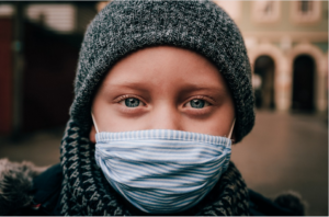 a child with a face mask